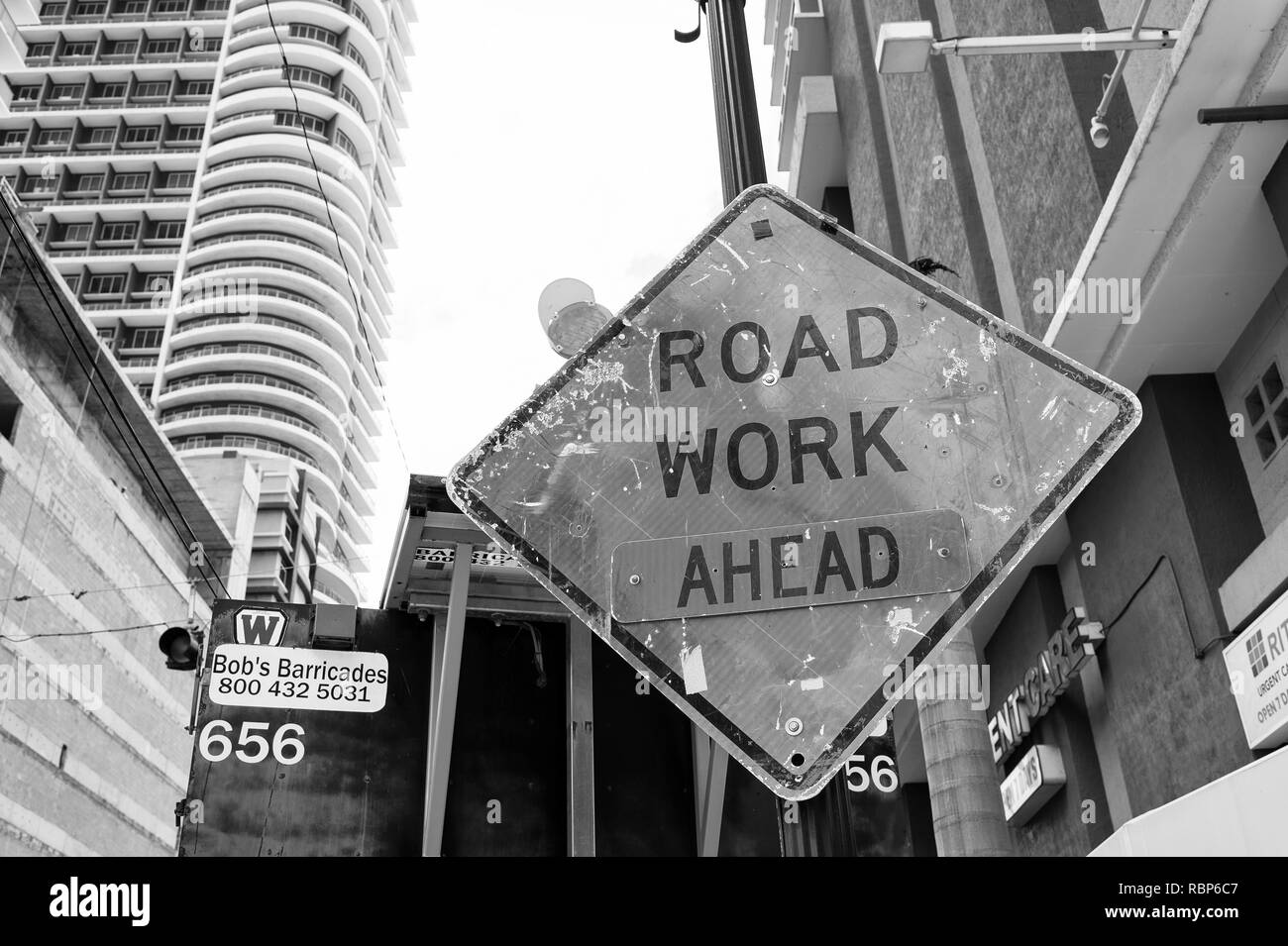 Miami, USA - October 30, 2015: construction sign on city road. Road work ahead warning and safety. Transportation traffic and travel. Caution and warn concept. - Stock Image
