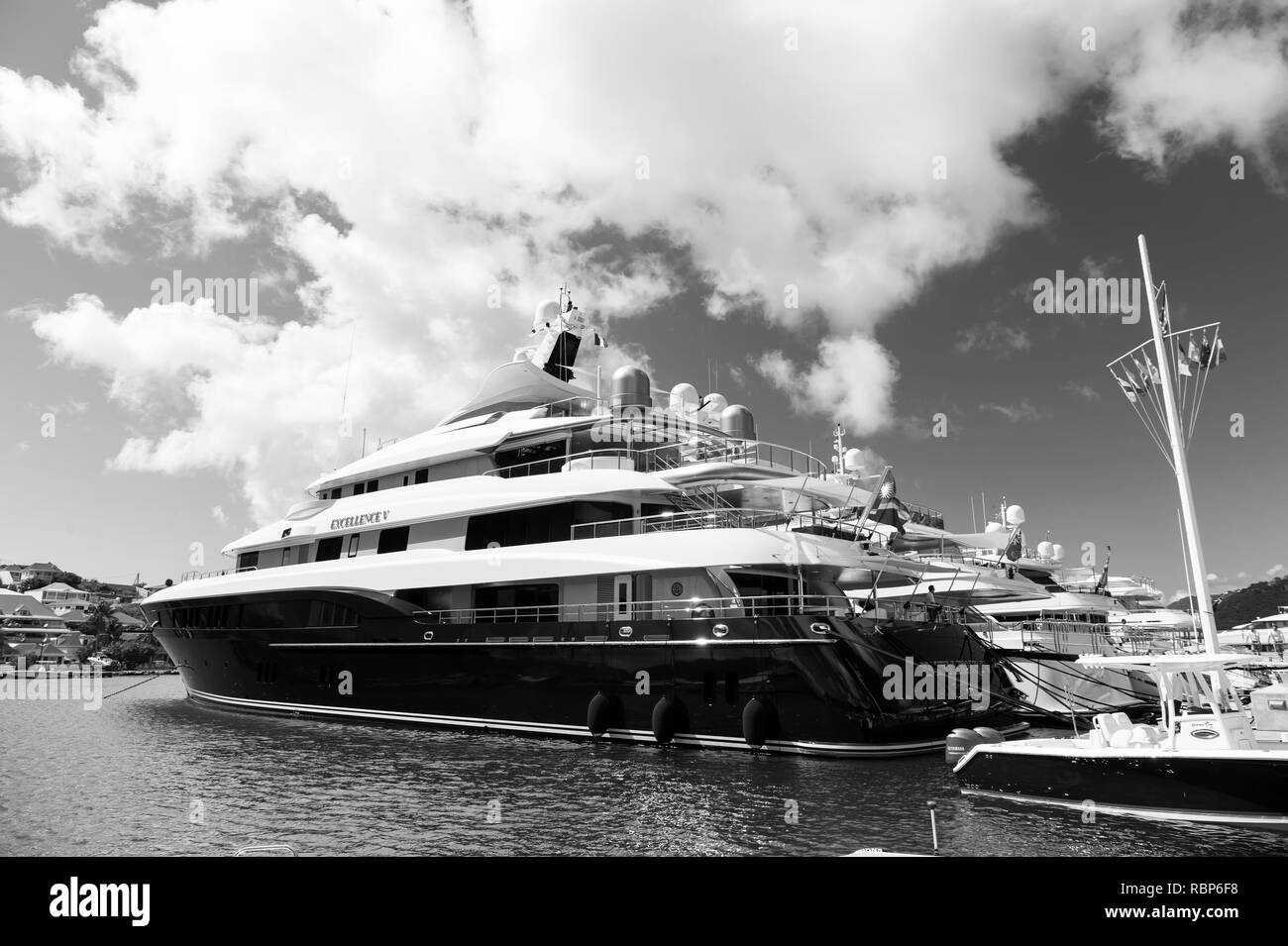 Gustavia, st.barts - January 25, 2016: water transport and vessel. Yachts anchored at sea pier on tropical beach. Yachting, luxury travel on yacht. Summer vacation on island wanderlust. - Stock Image