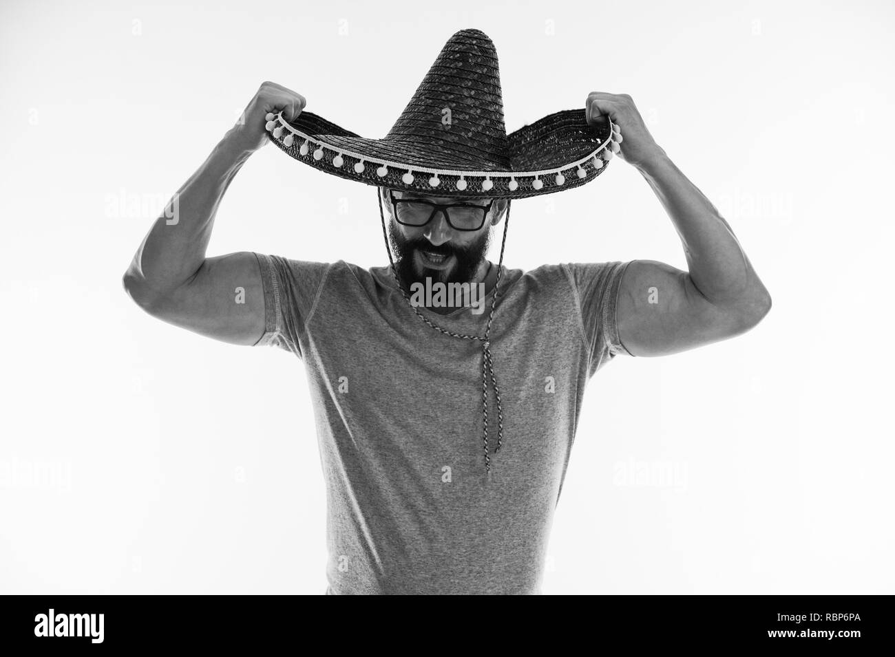 Muscular man in sombrero. Mexican man keep sombrero hat in muscular hands. Strength and masculinity. In love with mexico, black and white. - Stock Image