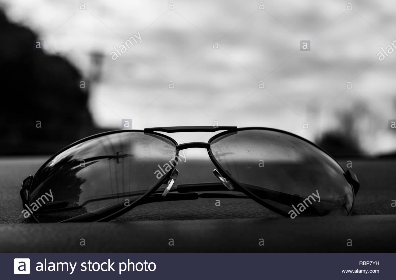 Sunglasses on dashboard - Stock Image