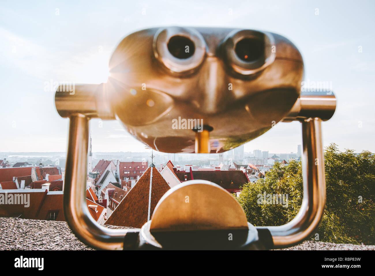 Sightseeing telescope binocular overlooking Tallinn city viewpoint in Estonia popular landmarks cityscape Europe summer travel vacations - Stock Image