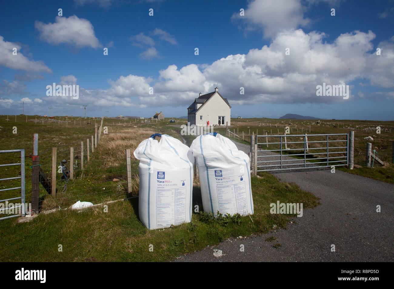 Nitrogen fertilzer in bags , ready for application to machir , coastal grazing . Threat to wildlife diversity of threatened coastal habitat. Necessaary for maintainance of low level subsidized agriculture in remote OuterHebrides - Stock Image