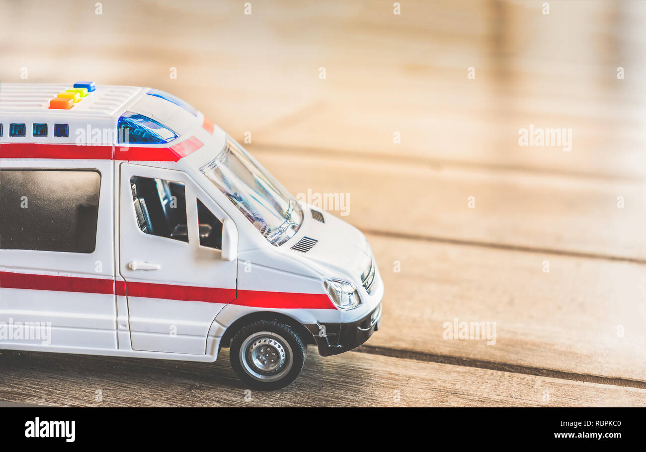 ambulance side view background health care toy close up - Stock Image