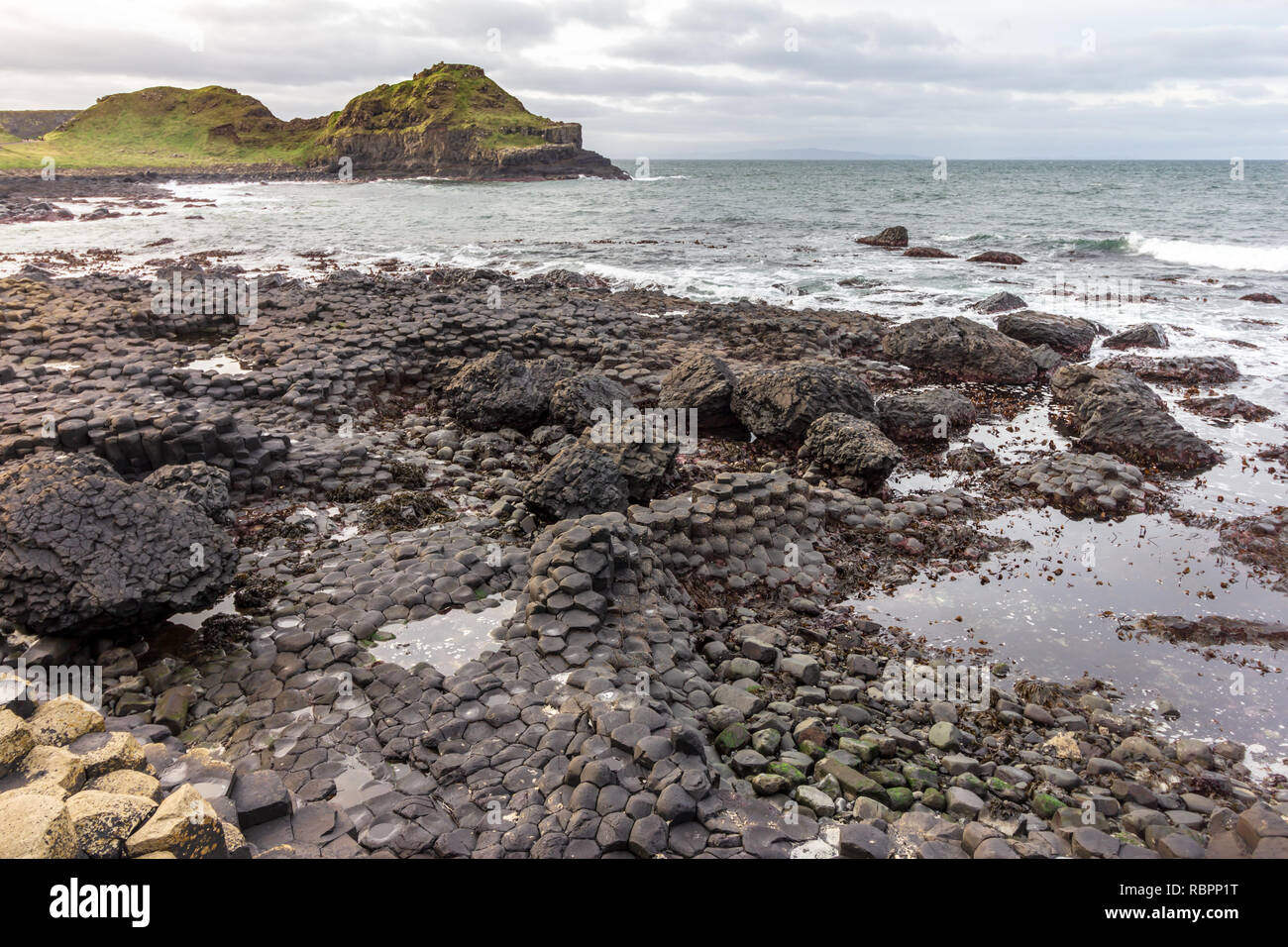 The Giants Causeway in Northern Ireland is known for its hexagonal basalt columns - Stock Image