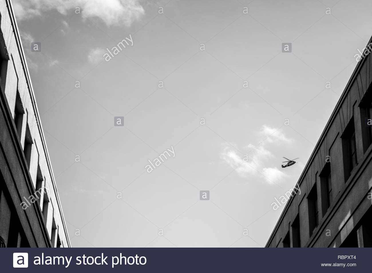 Helicopter near clouds - Stock Image