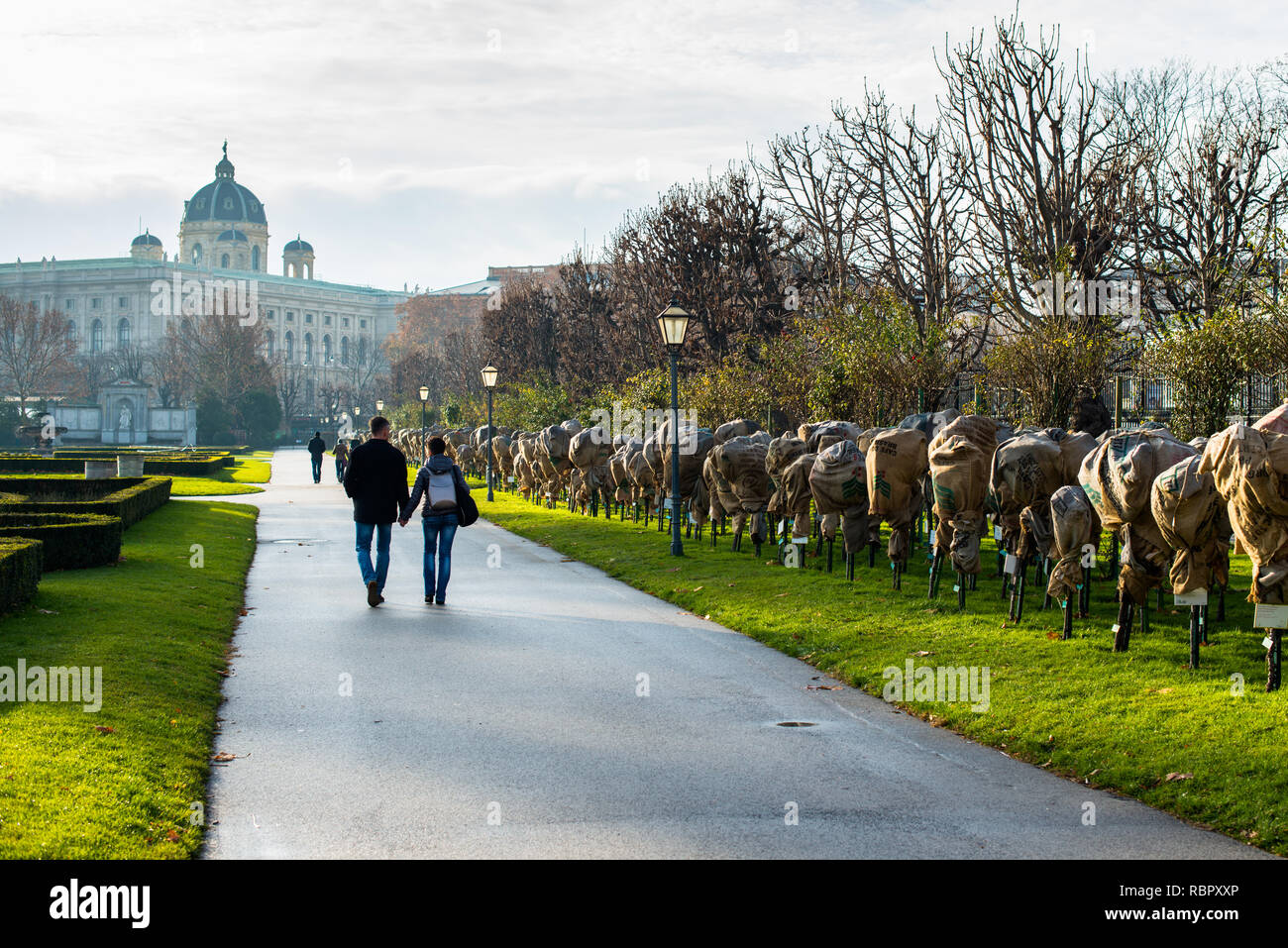 Atmospheric and romantic early morning walk along Volksgarten park and garden in Innere Stadt first district of Vienna, with Museum of Natural History. - Stock Image