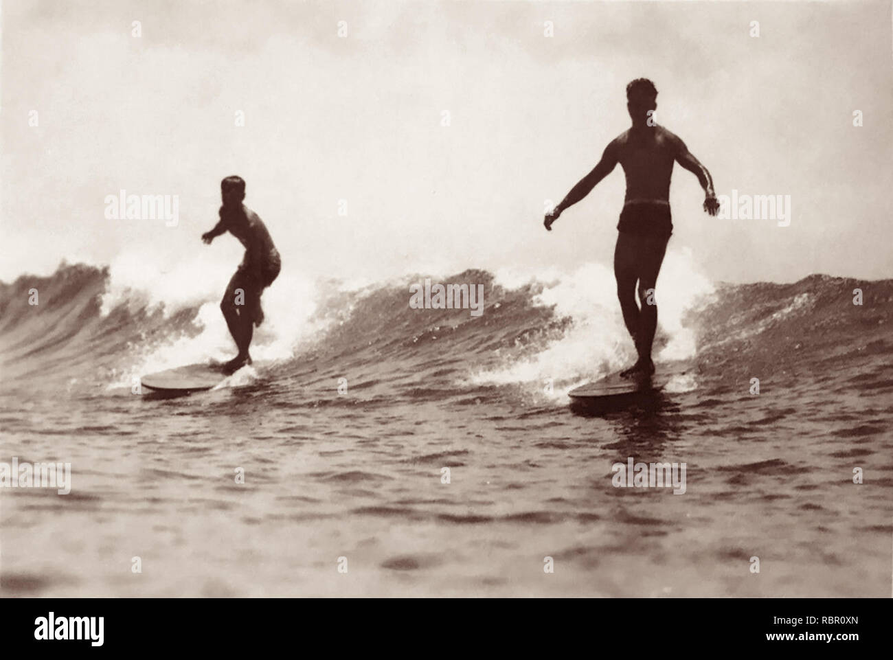 Early 20th century surfers at Waikiki, Honolulu, Territory of Hawaii. - Stock Image