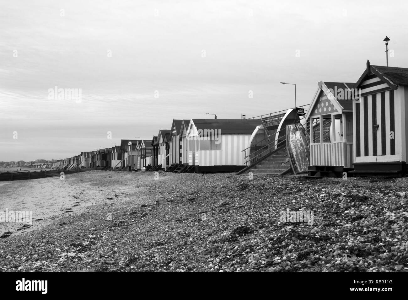 Black and white image of the beach huts at Stock Photo