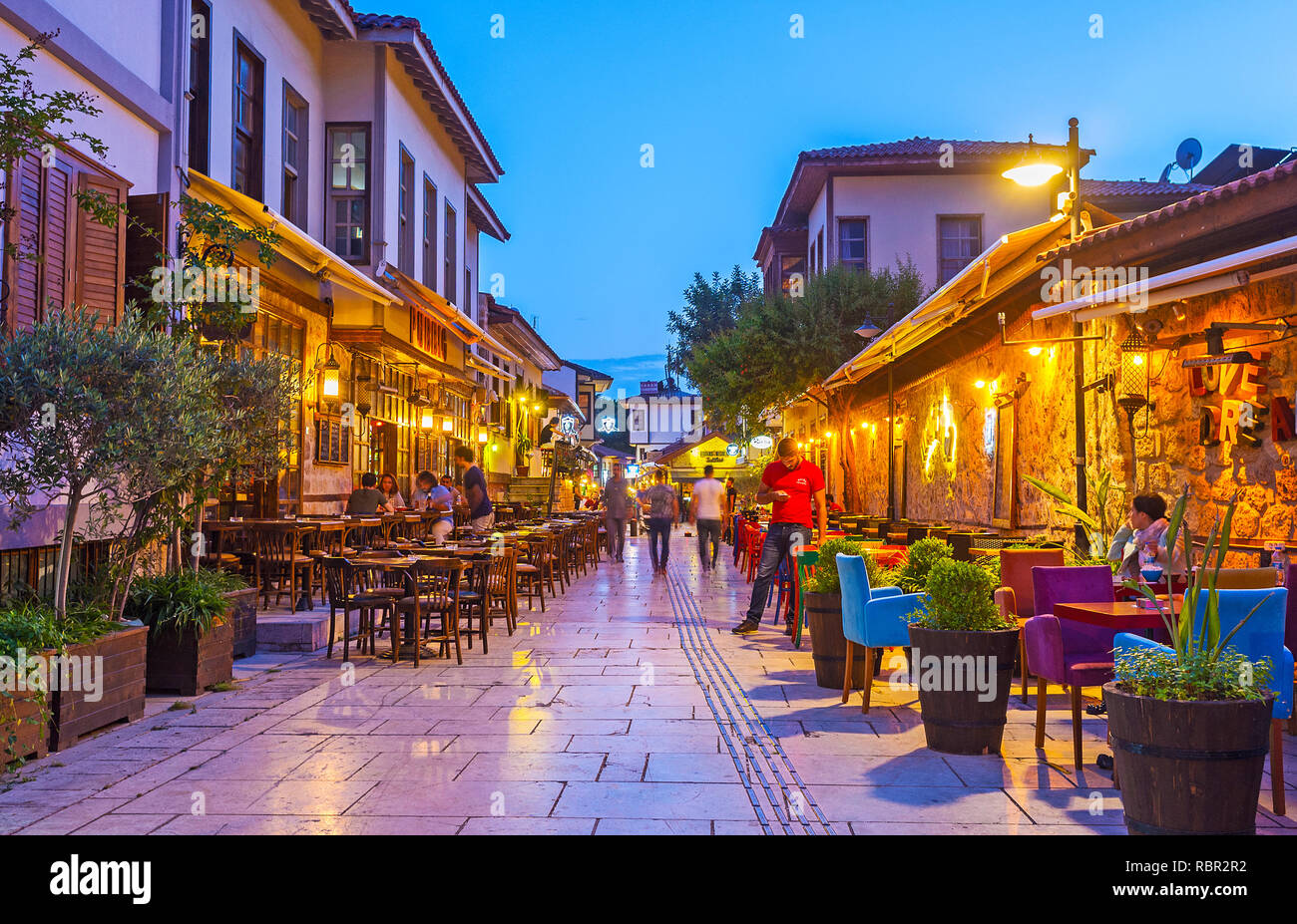 ANTALYA, TURKEY - MAY 9, 2017: The old town boasts different restaurants and cafes, occupying historical townhouses and offering nice time spending on - Stock Image