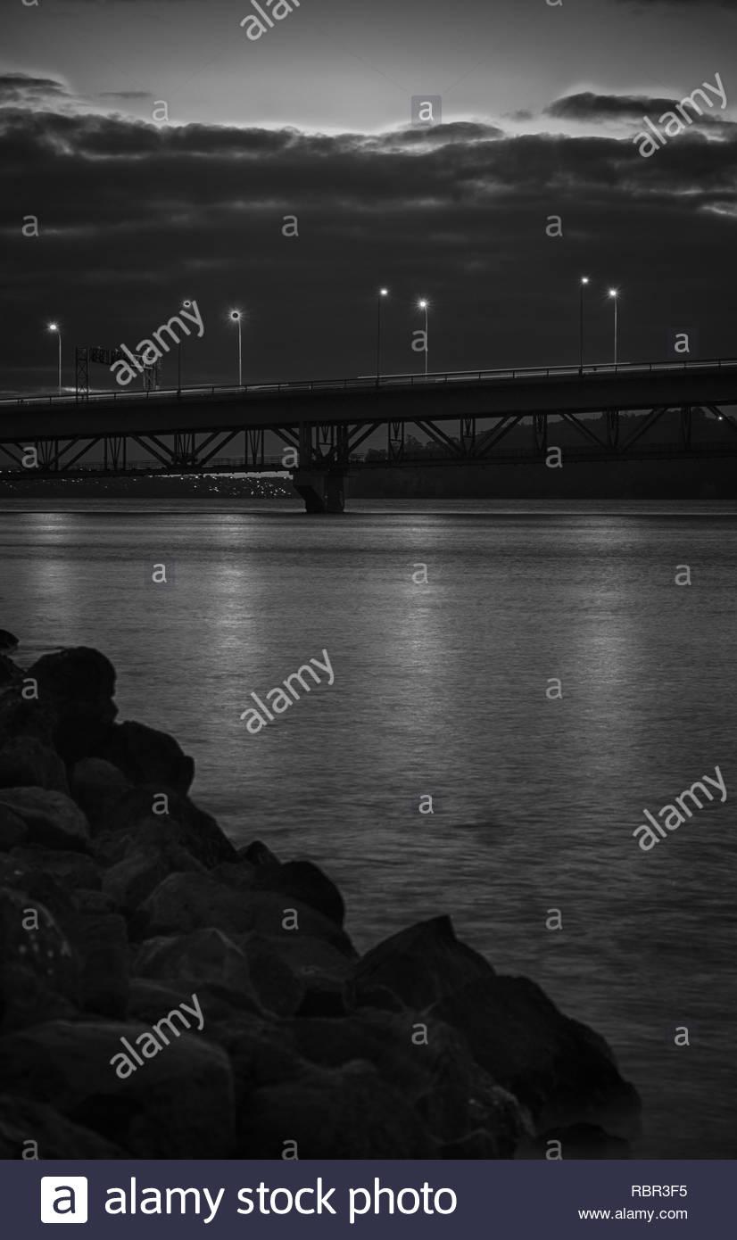 Auckland Harbour Bridge with rocks - Stock Image