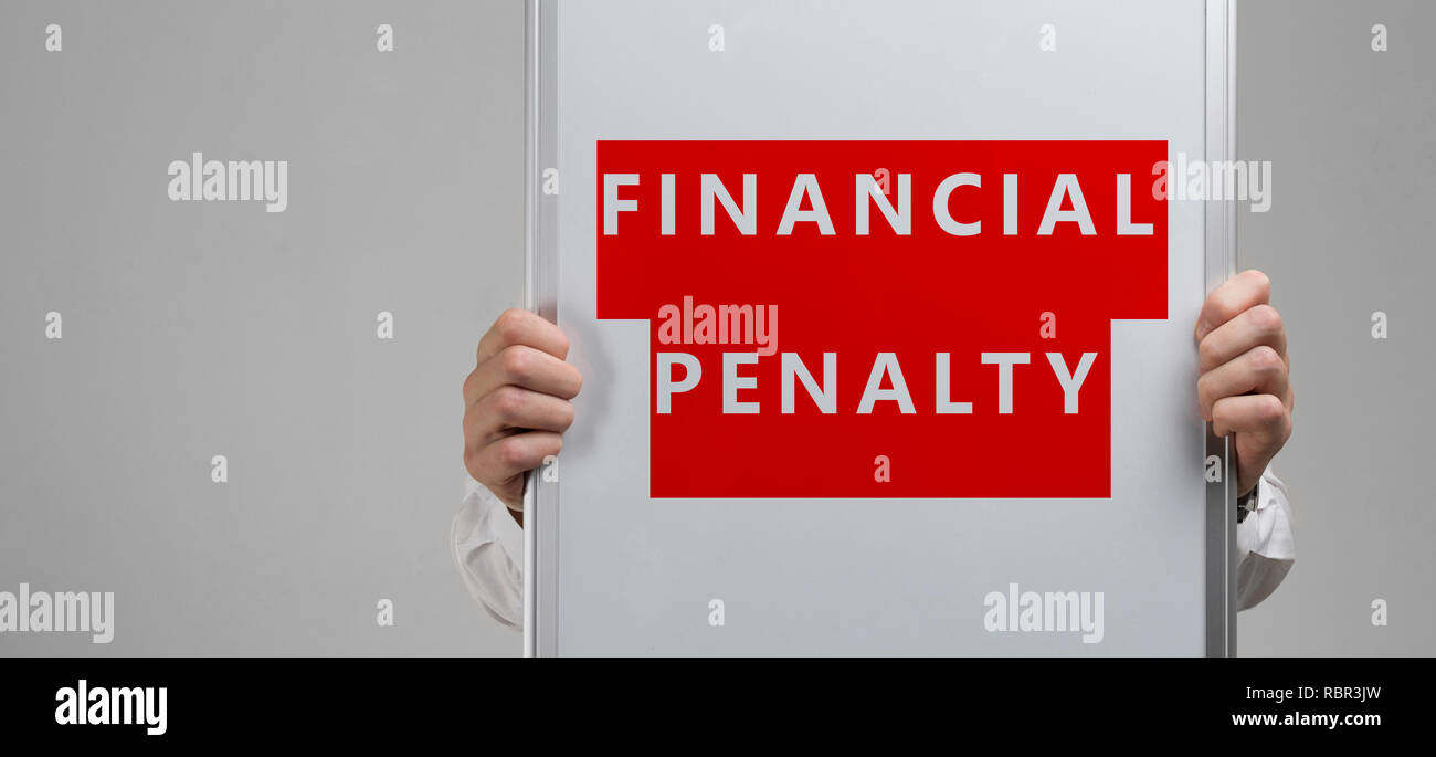 men's hands holding a poster with the inscription on a red background financial penalty is isolated - Stock Image