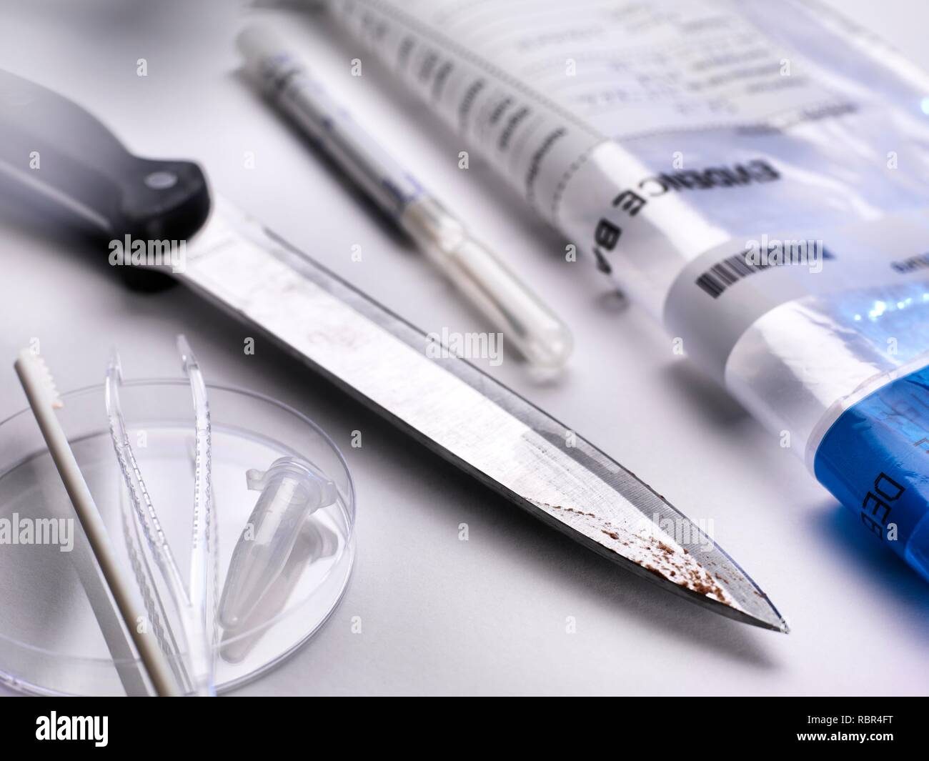 Forensic evidence collection. A knife about to be swabbed for DNA (deoxyribonucleic acid) and other forensic tests. - Stock Image