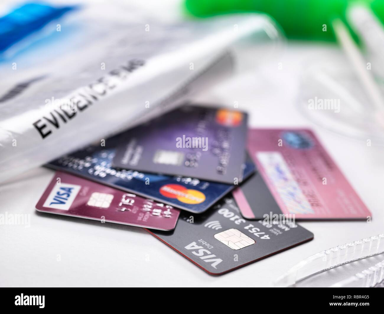 Credit cards taken from a crime scene. - Stock Image