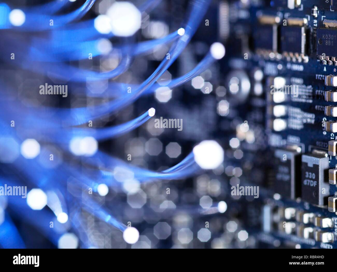 Fibre optics carrying data over electronic circuitry on a laptop computer. - Stock Image