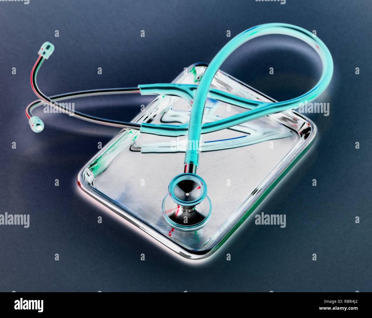 Stethoscope sitting on a medical tray. - Stock Image