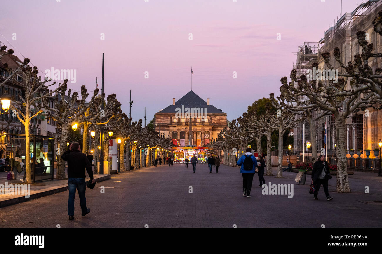 STRASBOURG, FRANCE - OCT, 25, 2018: Opera national du Rhin building as seen from place Broglie at sunset with pedestrians walking in background - Stock Image