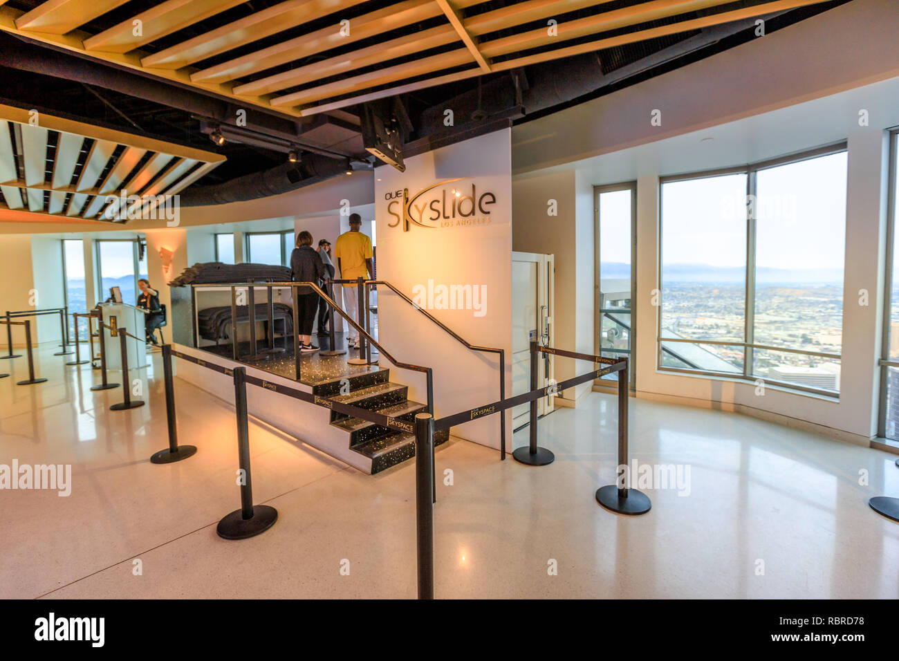 Los Angeles, California, United States - August 9, 2018: people waiting to make a ride on the Skyslide all-glass at popular US Bank Tower with open-air terrace over the downtown LA. - Stock Image