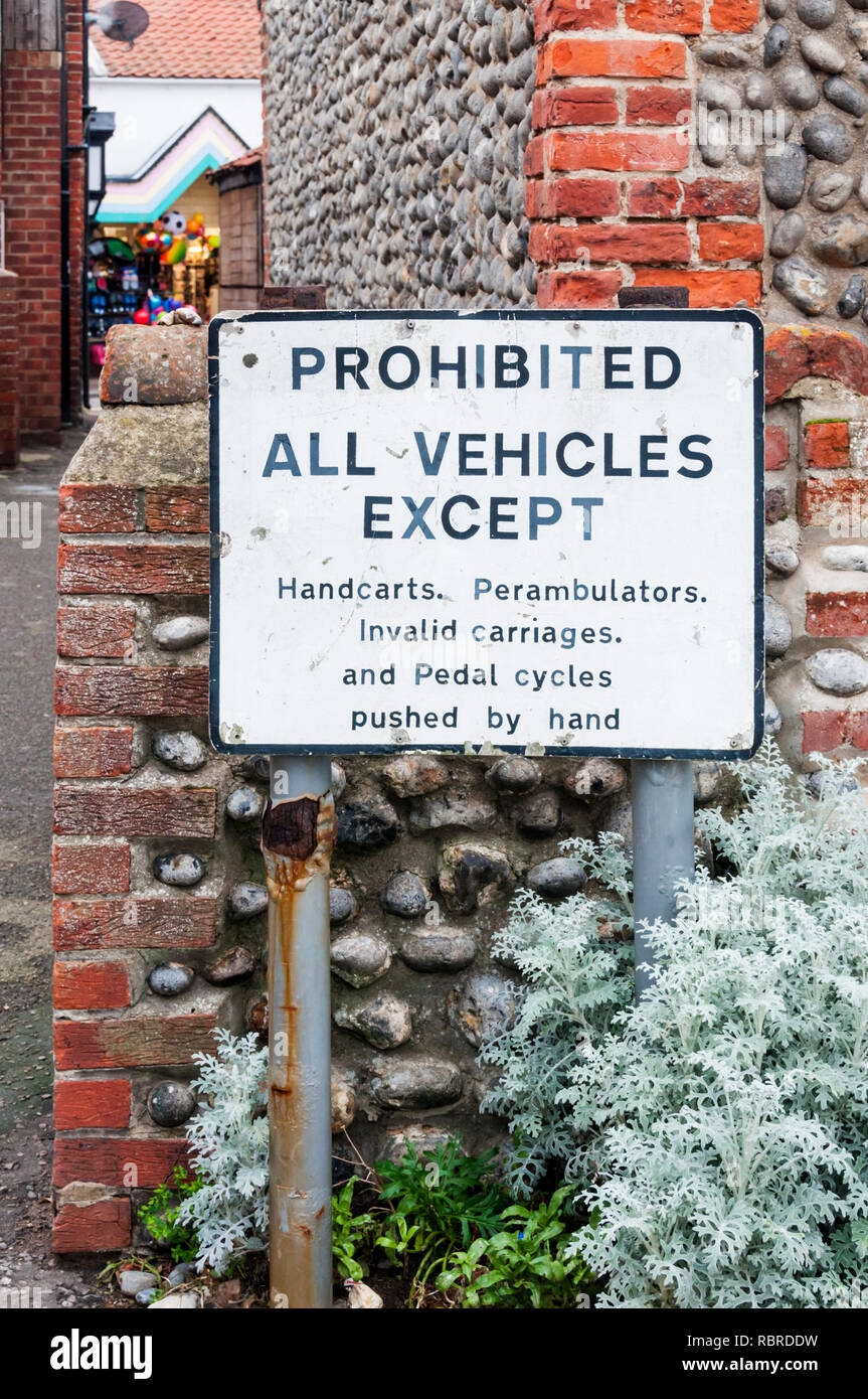 Old road sign in Sheringham, North Norfolk, prohibits all vehicles except handcarts, perambulators, invalid carriages and pedal cycles pushed by hand. - Stock Image