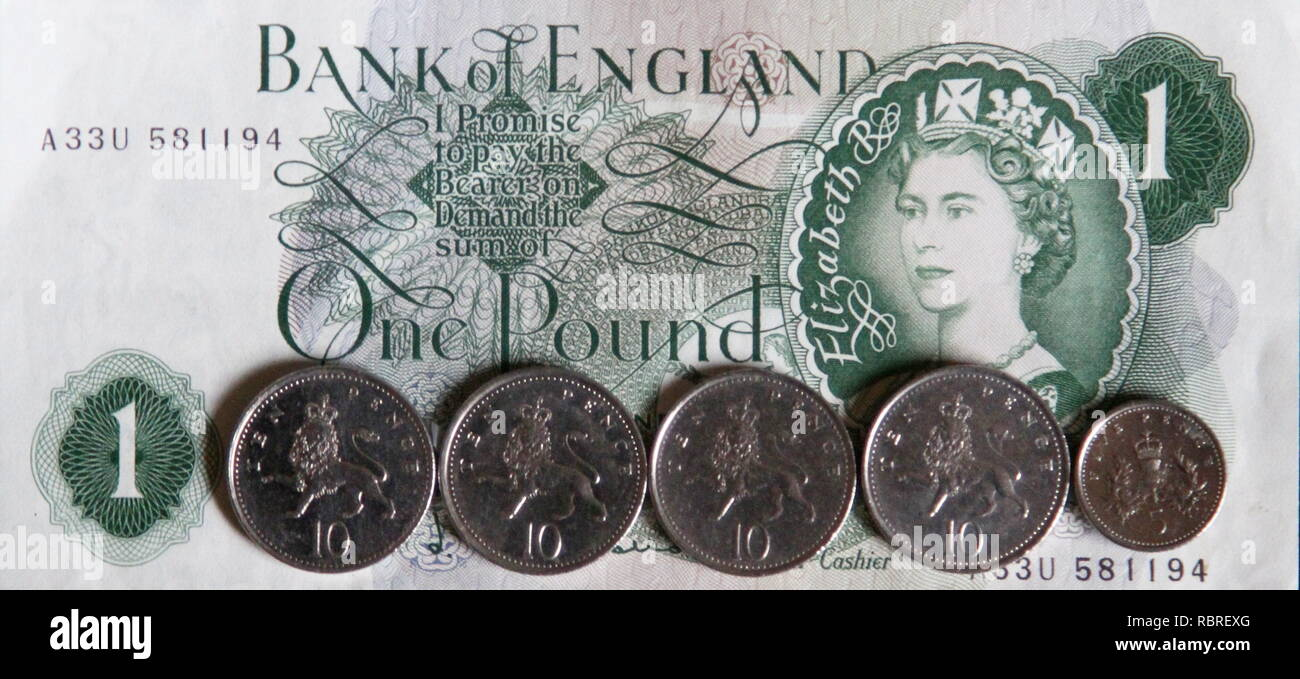 Bank of England One Pound note and 45 pence in coins. currency . The one pound note has been replaced by a one pound coin. - Stock Image