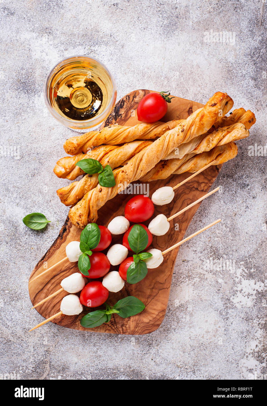 Caprese skewers and grissini bread - Stock Image