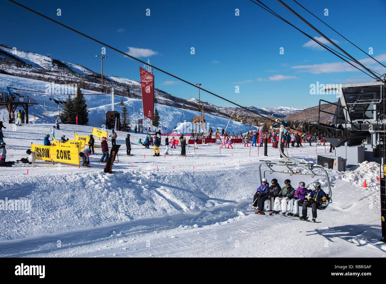 Children, adults, moms and dads enjoy a day at Park City Ski Resort in Utah. - Stock Image