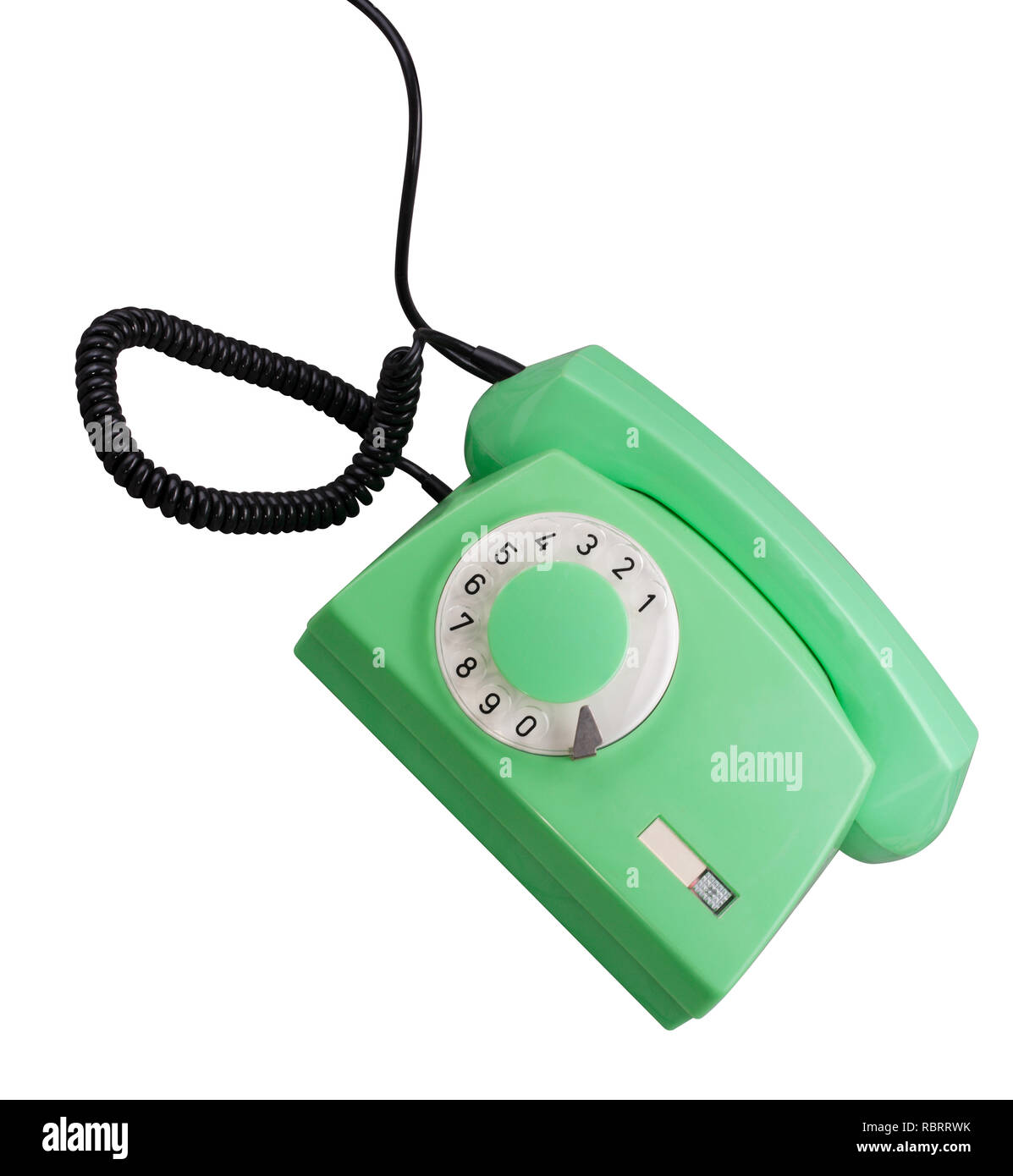Old Green Rotary Telephone isolated - Stock Image