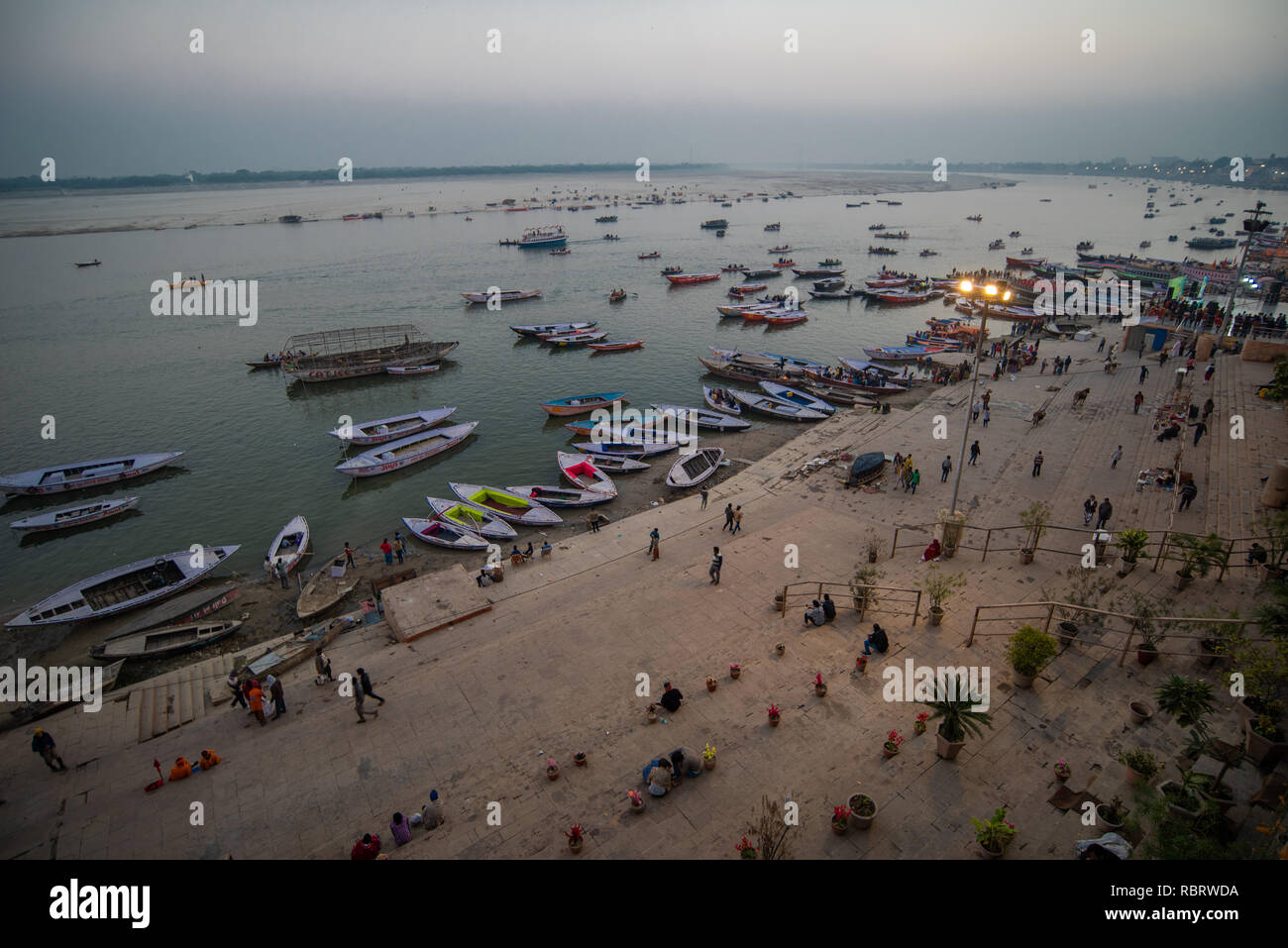 Elevated blue hour (post sunset) scene of the Ganges with boats in the river in Varanasi, India - Stock Image