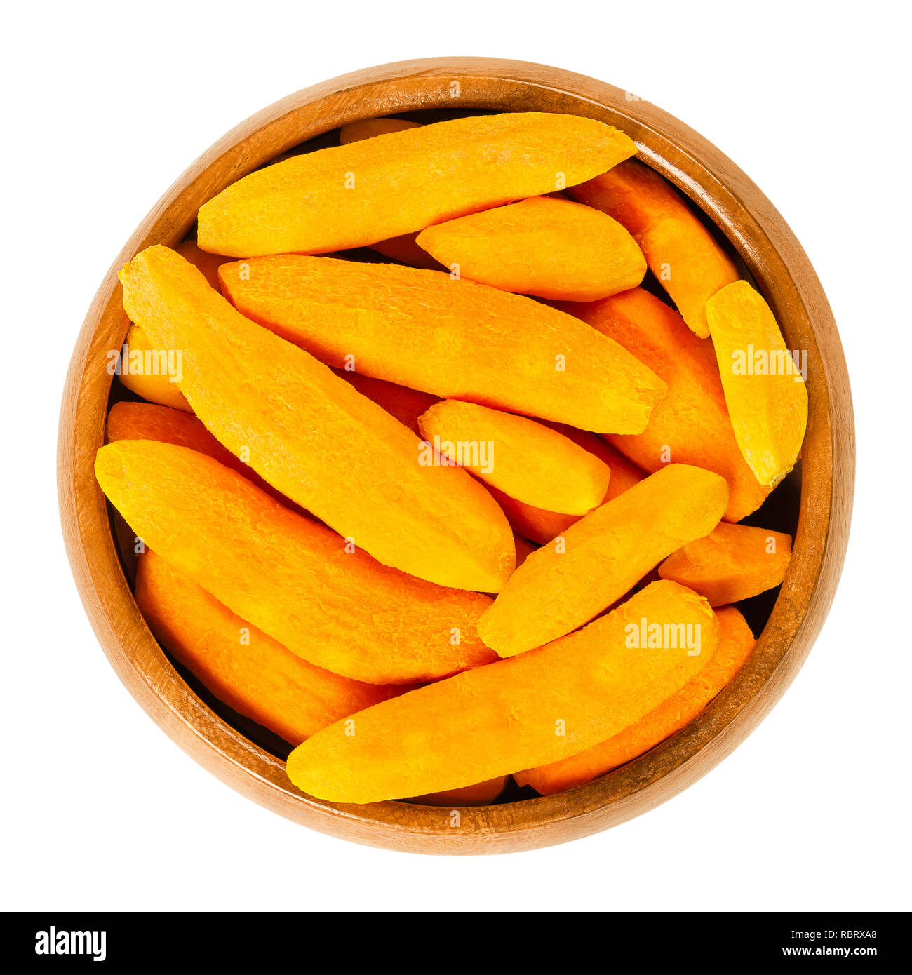 Peeled turmeric rhizomes in wooden bowl. Fresh roots of Curcuma longa, tumeric, with orange color. Spice for curries, coloring mustard and medicine. - Stock Image