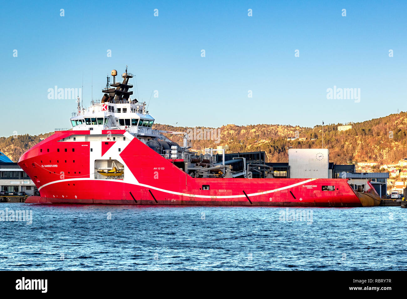 Offshore AHTS Anchor Handling Tug Supply vessel KL Sandefjord in the port of Bergen, Norway. - Stock Image