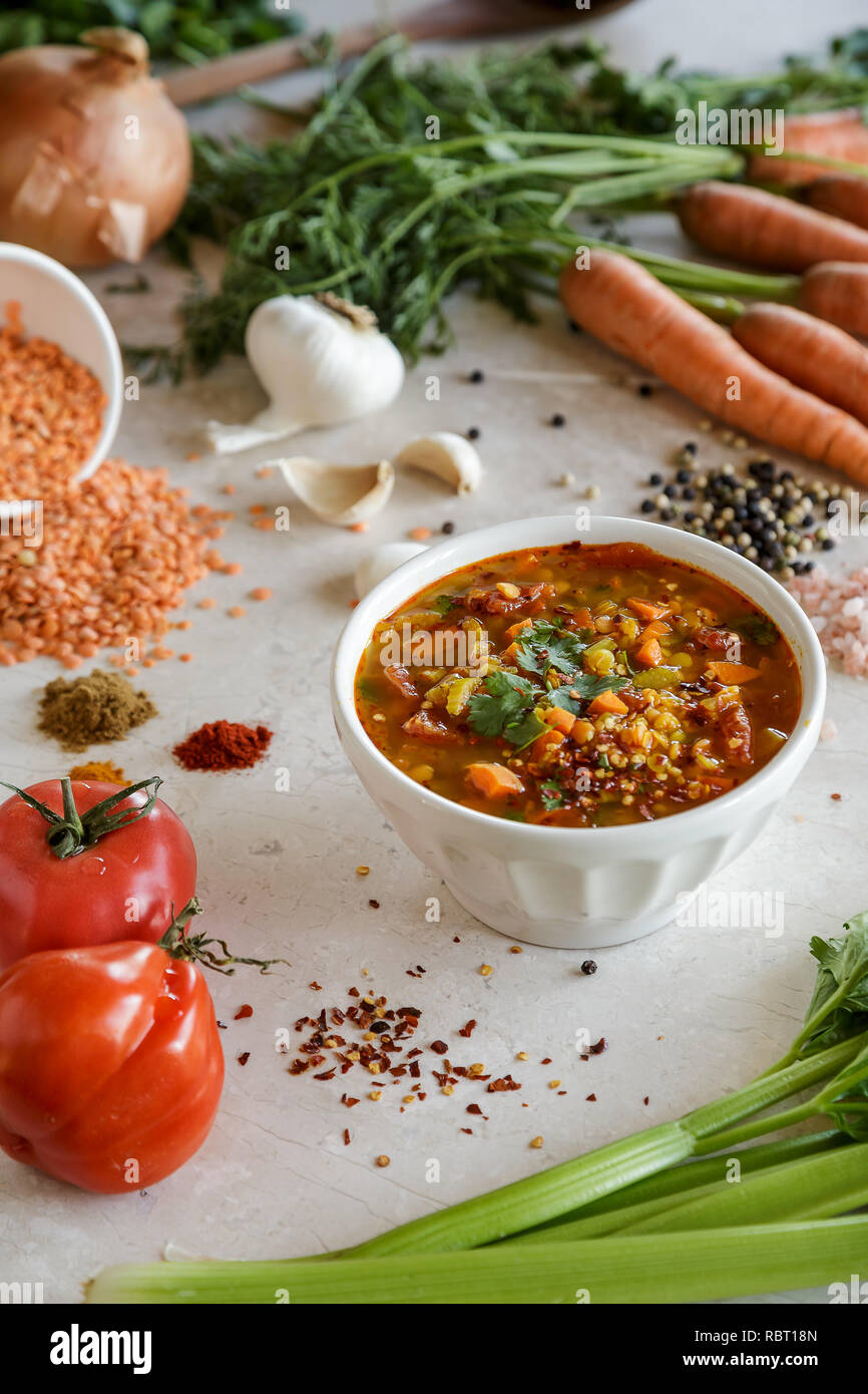 Hearty Lentil Vegetable Soup displayed with Ingredients - Stock Image