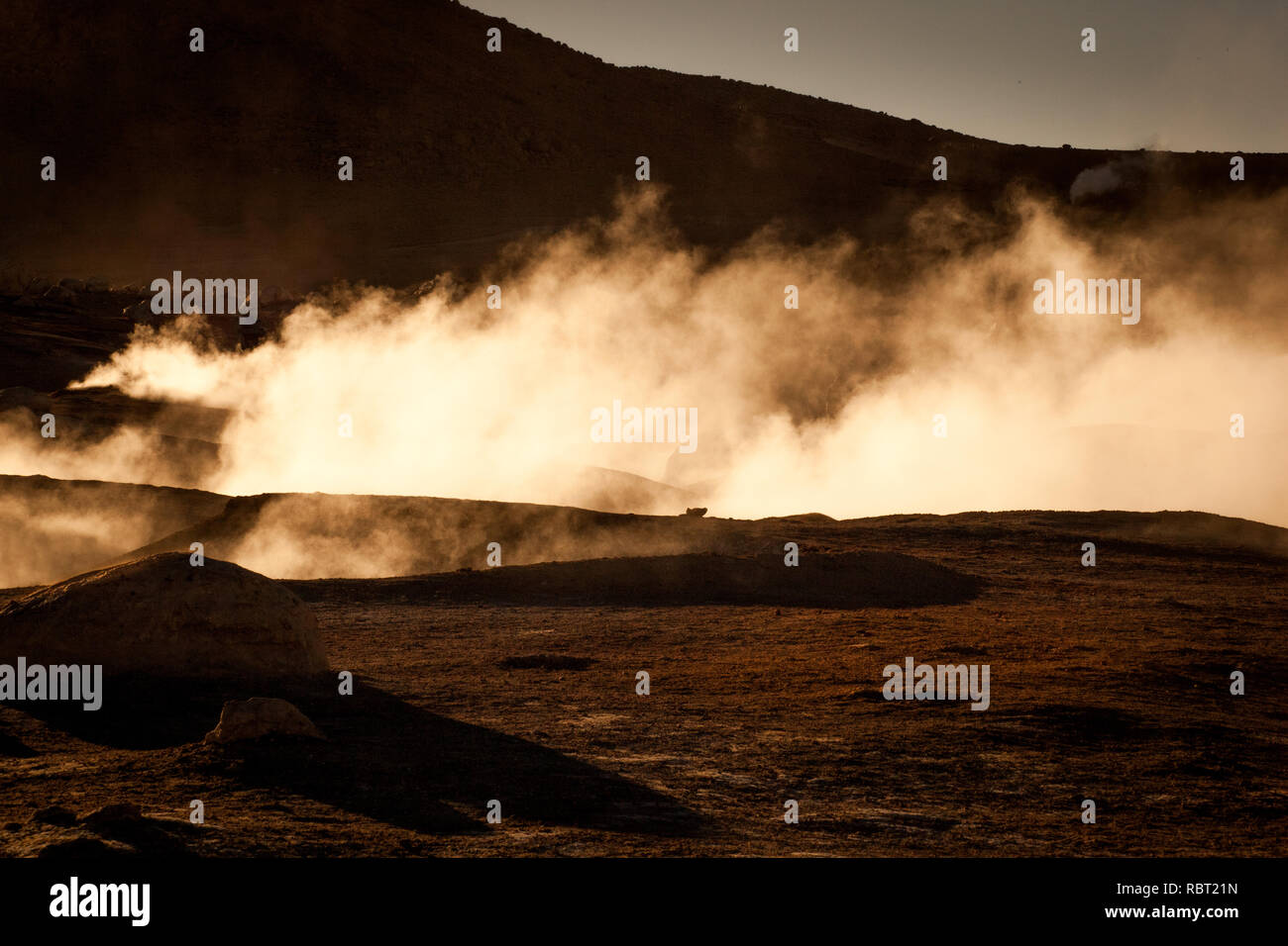 Steam rises from a fumarole as geothermal activity under the ground is producing clean, renewable and sustainable energy. - Stock Image