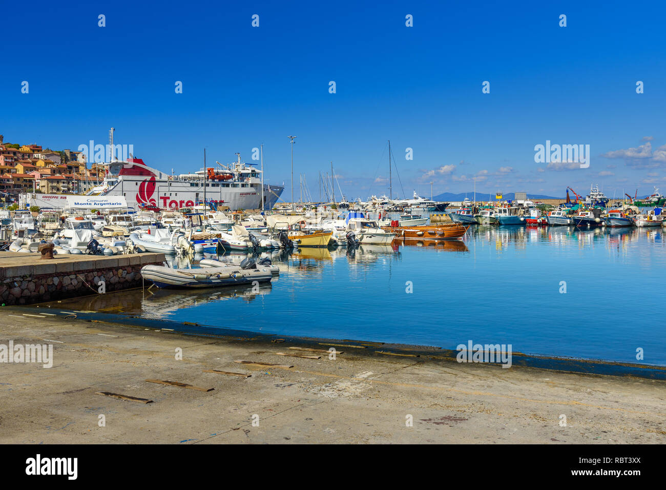 Porto Santo Stefano, Italy - October 09, 2018: View of harbor seafront in seaport town Porto Santo Stefano in Monte Argentario. Tuscany - Stock Image