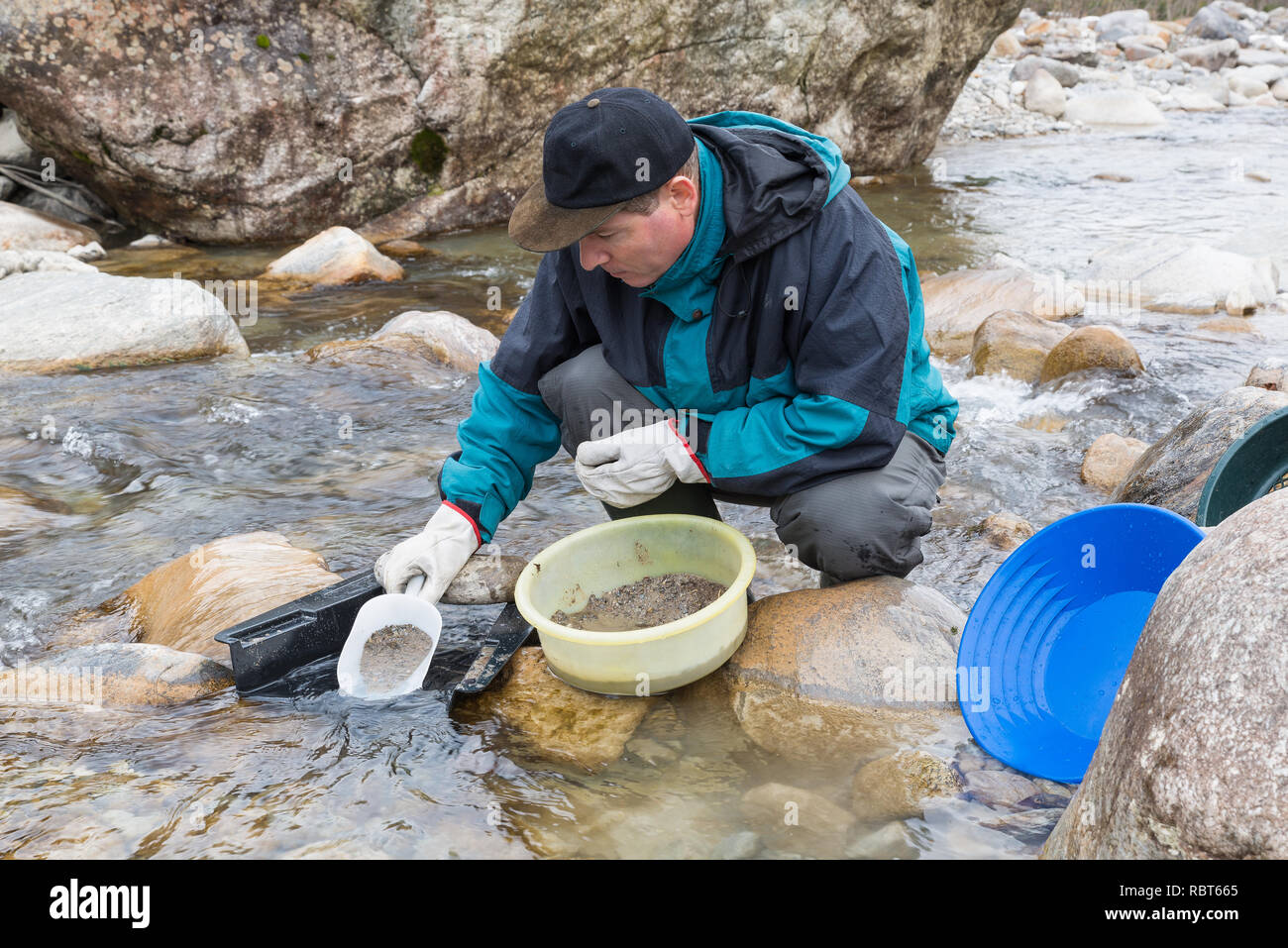Adventures on the river. Modern alluvial gold prospector - Stock Image