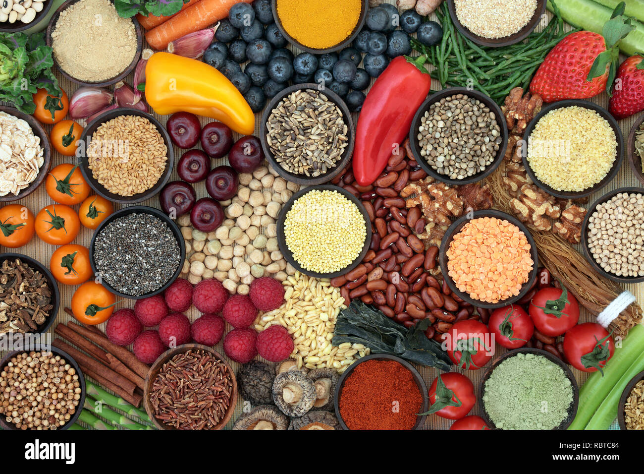 Liver detox diet health food concept with fresh fruit, vegetables, herbs, spices, supplement powders, legumes, herbal medicine, grains, nuts and seeds - Stock Image