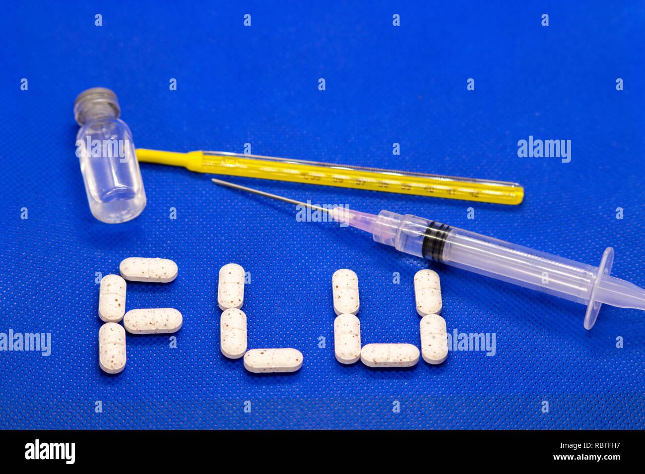 Set of cold medicine and flu virus on blue background.  Antibiotics, homeopathy, pills. Medicine and drug concept. - Stock Image