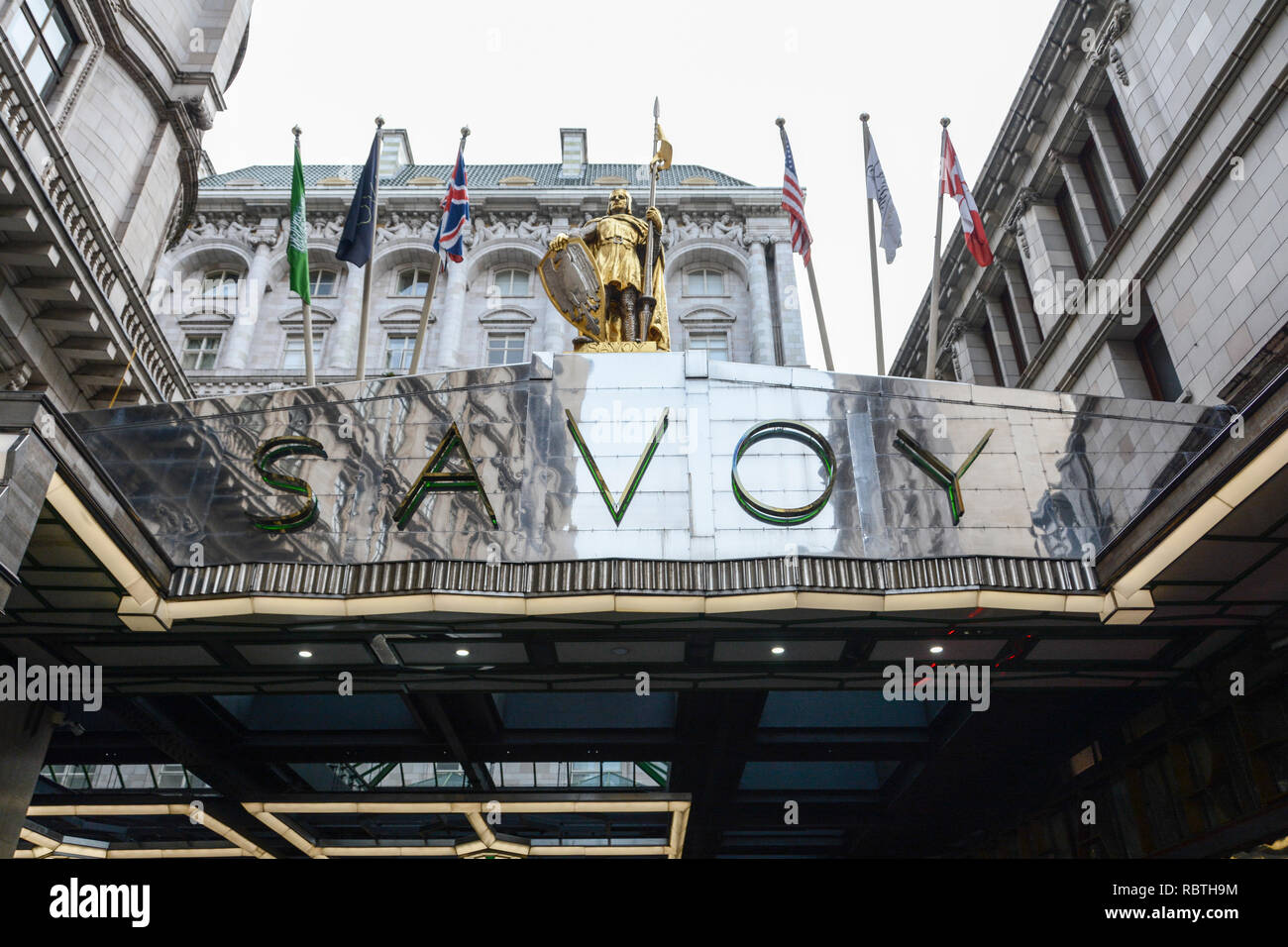 Frontage and entrance to the luxury Savoy Hotel on the Strand, London, UK - Stock Image