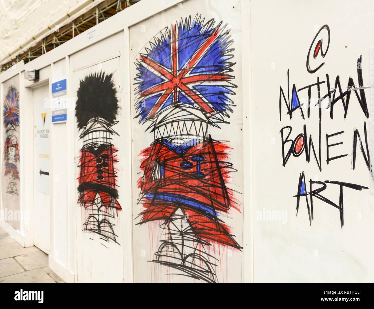 Street artist Nathan Bowen's Grenadier Guardsmen wearing bearskins in Trafalgar Square, London, UK - Stock Image