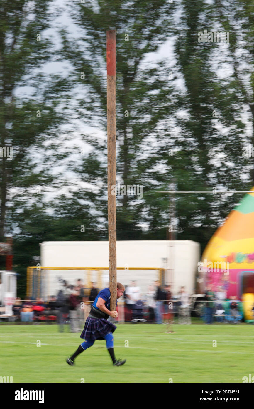 tossing the caber at the Scottish Highland Games Stock Photo