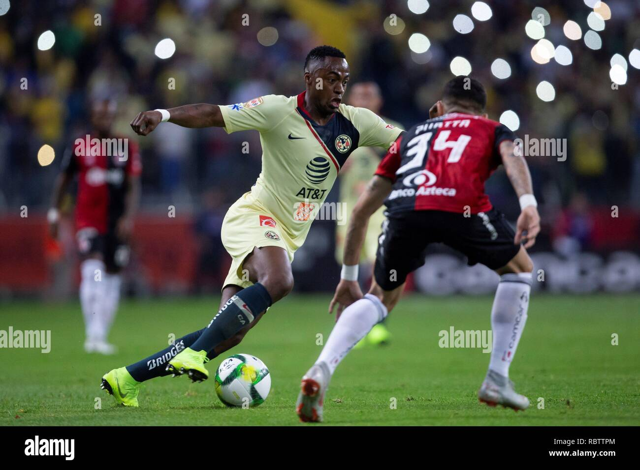 Guadalajara, Mexico. 12th Jan, 2019. Irving Zurita (R) of Atlas vies for the ball against Alex Ibarra (L) of America, during the game corresponding to day 2 of the Mexican soccer tournament, held at the Jalisco Stadium, in the city of Guadalajara, Mexico, 11 January 2019. EFE/ Francisco Guasco Credit: EFE News Agency/Alamy Live News - Stock Image
