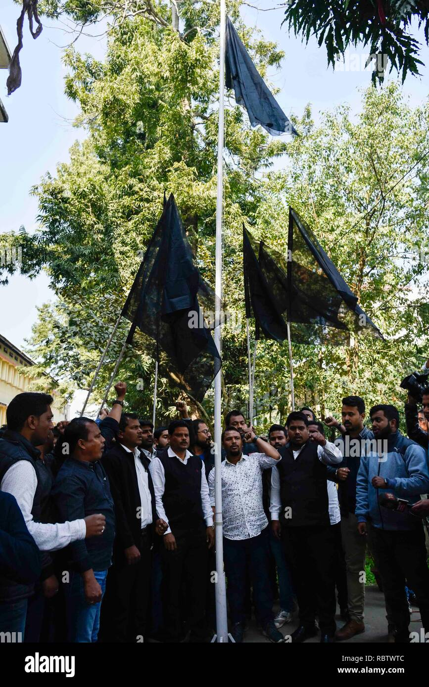 Guwahati, Assam, India. 12th Jan, 2019. Protest against Citizenship (Amendment) Bill. Guwahati, Assam, India on Saturday, January 12, 2019. All Assam Students' Union(AASU) activists hoist black flags as they raise slogan against Citizenship (Amendment) Bill, 2016. India's lower house passed legislation that will grant citizenship to members of certain religious minorities but not Muslims. - The bill covers select groups -- including Hindus, Christians and Sikhs -- who moved from Bangladesh, Pakistan and Afghanistan and who have lived in India for at least six years. Credit: David Talukdar/Alam - Stock Image