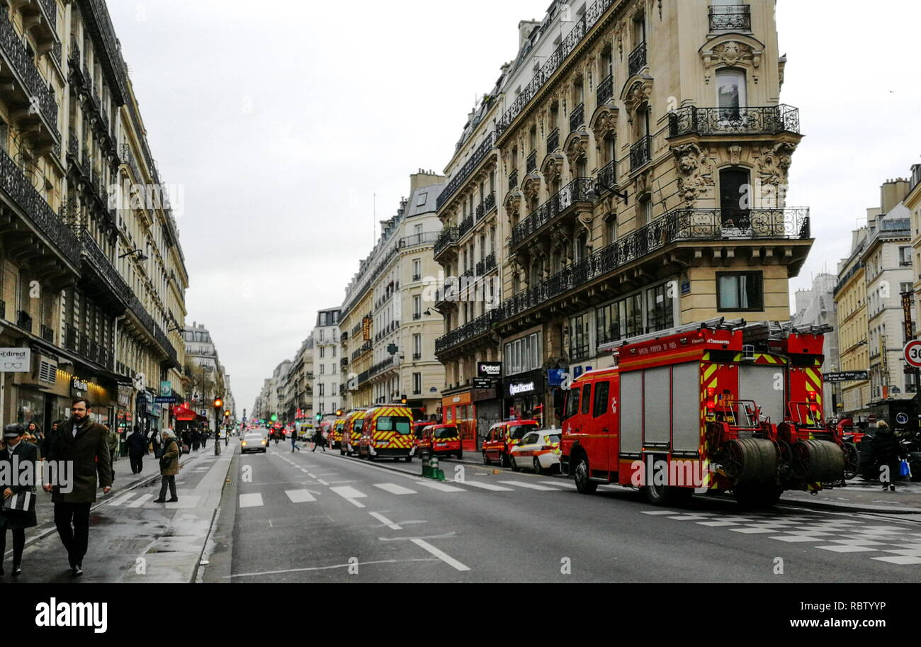 Paris, France. 12th Jan, 2019. PARIS, FRANCE - JANUARY 12, 2019: Emergency services at the scene of a gas explosion in a bakery at the Rue de Trevise Street in the 9th Arrondissement of Paris; fire fighters had arrived at the Rue de Trevise Street before the explosion, in response to a gas odour call; several fire fighters have been injured in the blast, according to French mass media reports. Dmitry Orlov/TASS Credit: ITAR-TASS News Agency/Alamy Live News - Stock Image