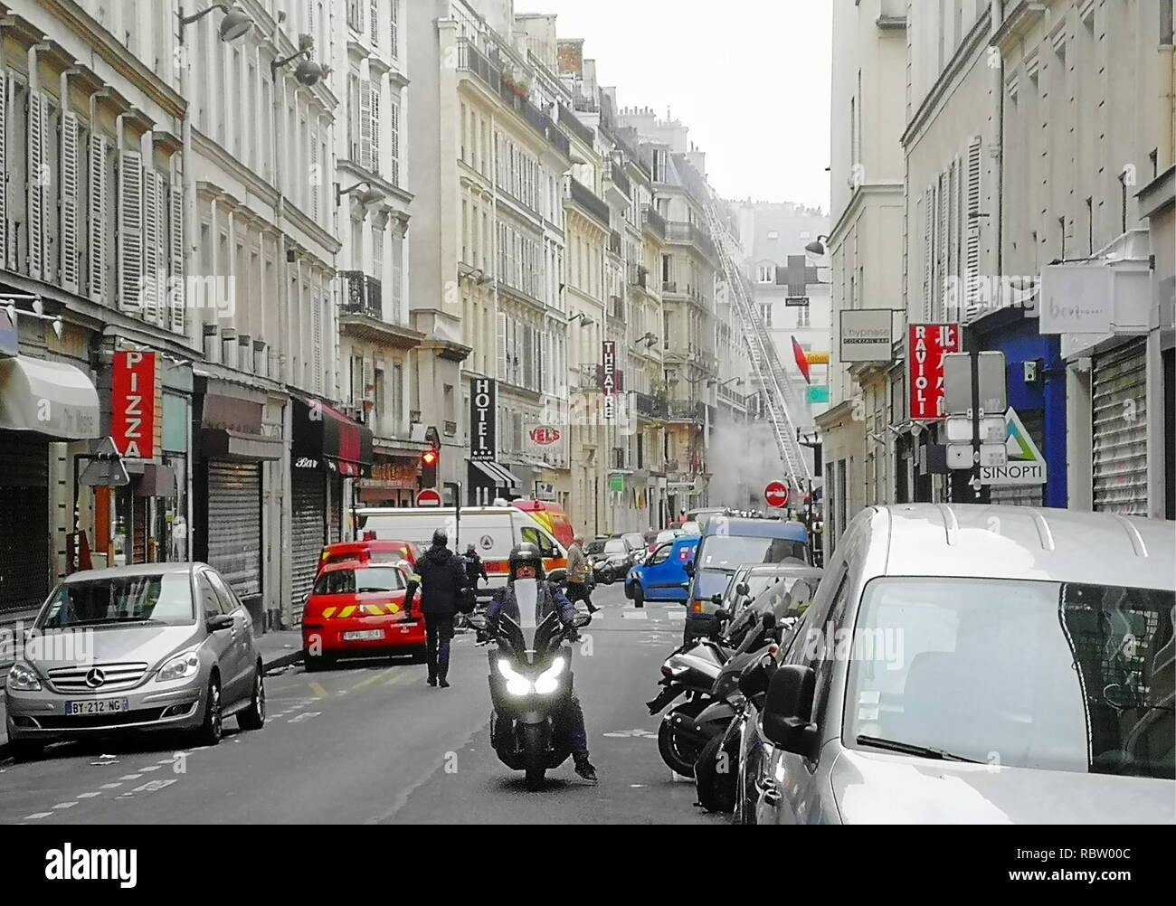Paris, France. 12th Jan, 2019. PARIS, FRANCE - JANUARY 12, 2019: Emergency services at the scene of a gas explosion in a bakery at the Rue de Trevise Street in the 9th Arrondissement of Paris; fire fighters had arrived at the Rue de Trevise Street before the explosion, in response to a gas odour call; several fire fighters have been injured in the blast, according to French mass media reports. Dmitry Orlov/TASS Credit: ITAR-TASS News Agency/Alamy Live News Stock Photo