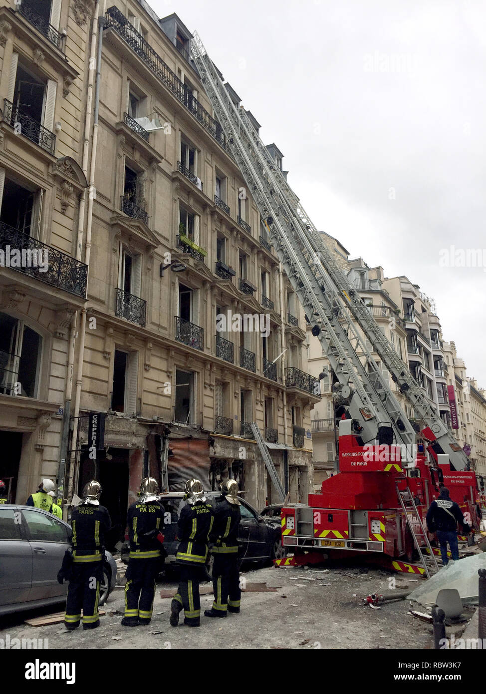 Paris, France.12 January 2019, France (France), Paris: After the explosion, firefighters are standing in a bakery (not in the picture) in front of an adjacent residential building. There was an explosion in the morning at a bakery in the centre of Paris. Two people lost their lives, several people were injured. Photo: Julia Naue/dpa Credit: dpa picture alliance/Alamy Live News - Stock Image