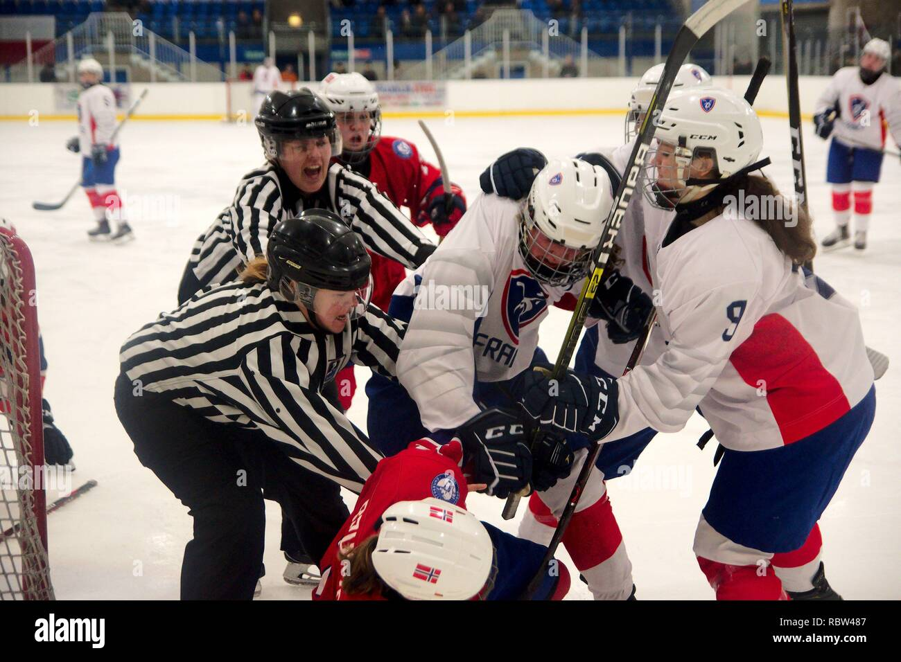 Dumfries, Scotland, 12 January 2019. Margot Rouquette, number 3, of France and Marthe Brunvold, number 11, of Norway pick up 2 minute penalties for roughing during their match against Norway in the 2019 Ice Hockey U18 Women's World Championship, Division 1, Group B, at Dumfries Ice Bowl. Credit: Colin Edwards/Alamy Live News. - Stock Image