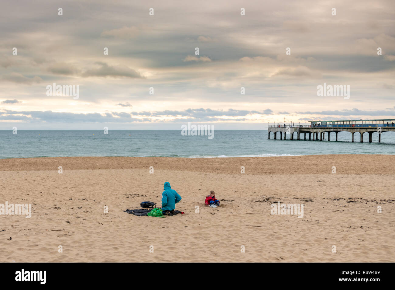 Bournemouth, Dorset, UK. 12th January 2019. Sitting on the beach, despite the cold weather in Bournemouth. Credit: Thomas Faull/Alamy Live News Stock Photo