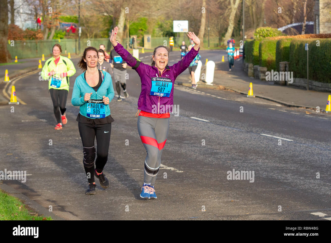 Stirling, Scotland, UK. 12th January, 2019. Runners have been taking part in this year's Great Stirling Castle Run, a challenging 7-kilometre course across the historic and picturesque Scottish city of Stirling. They were watched and cheered on by spectators as they crossed the finish line in King's Park. The event was sponsored by Simplyhealth. Iain McGuinness / Alamy Live News - Stock Image