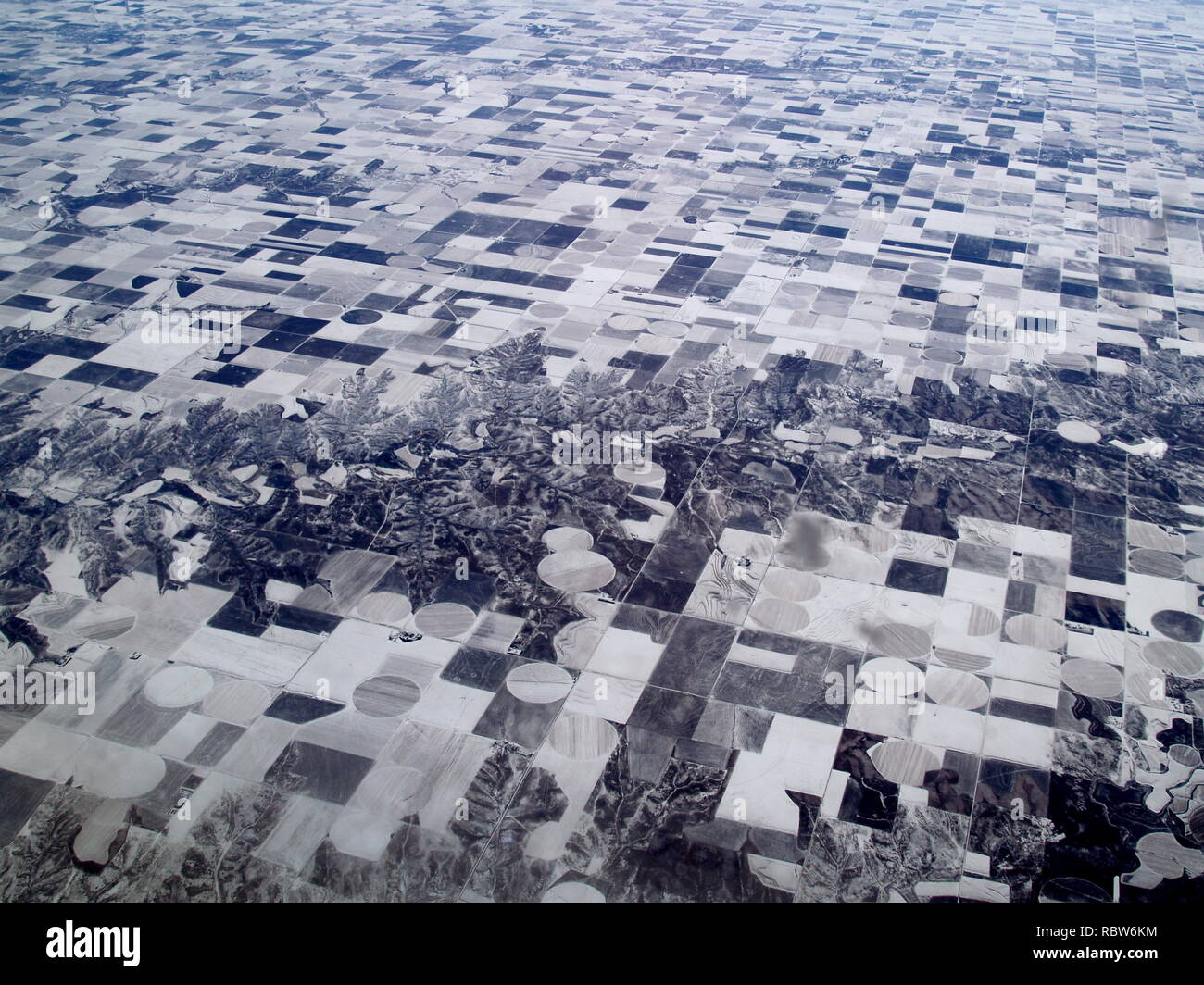 View of snow cover fields from airplane - Stock Image