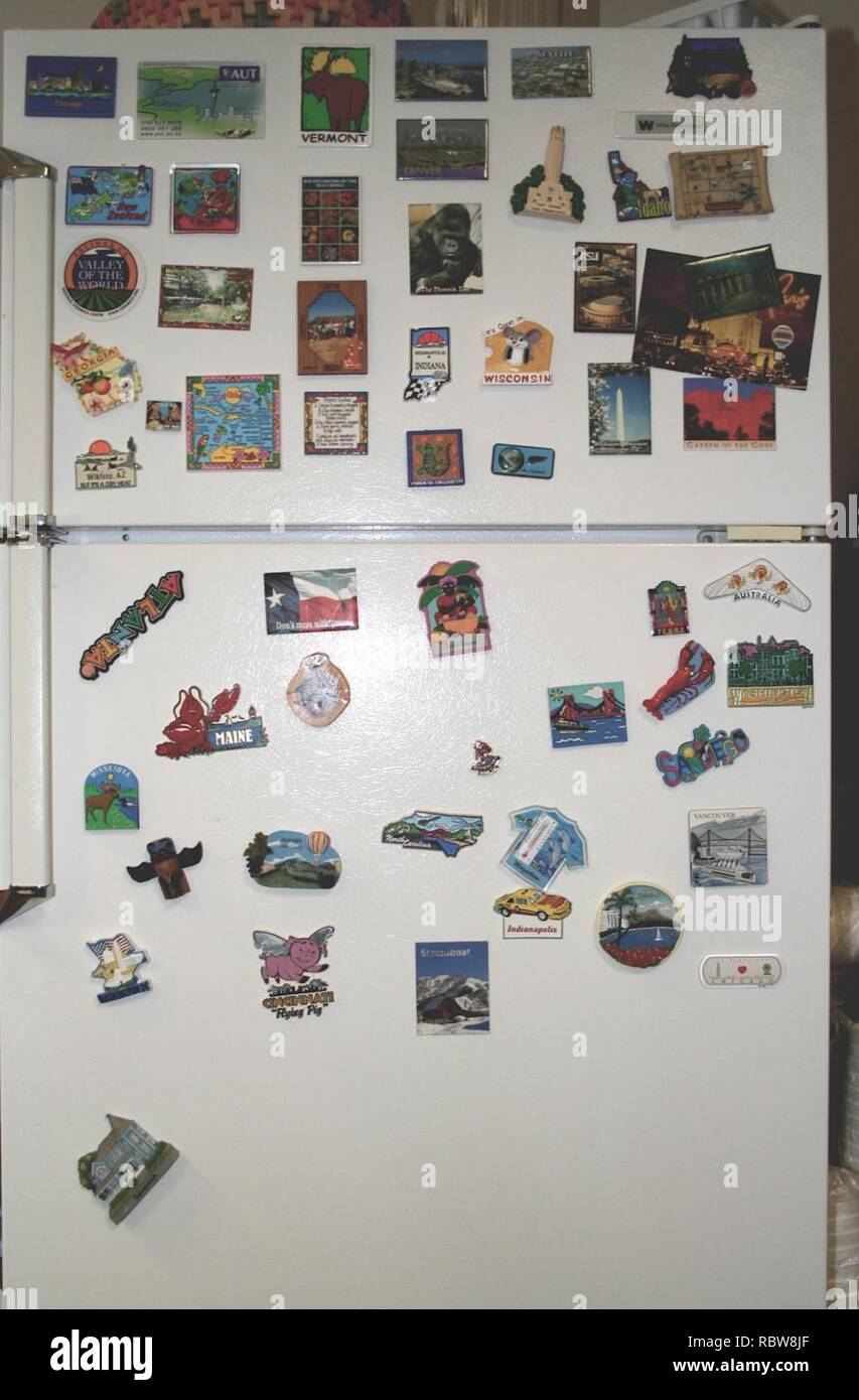A few years ago I suggested to our office that whenever we travel for a conference, we return with a fridge magnet from the place we went to- the cheesier the better. (117804788). - Stock Image