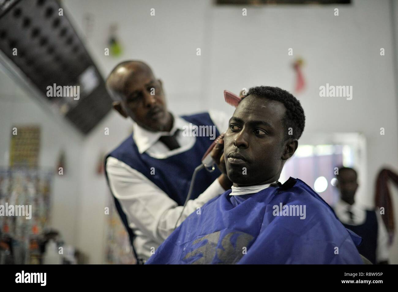 A Hairdresser Gives A Haircut At Abdulqadir Abduls Newly Opened