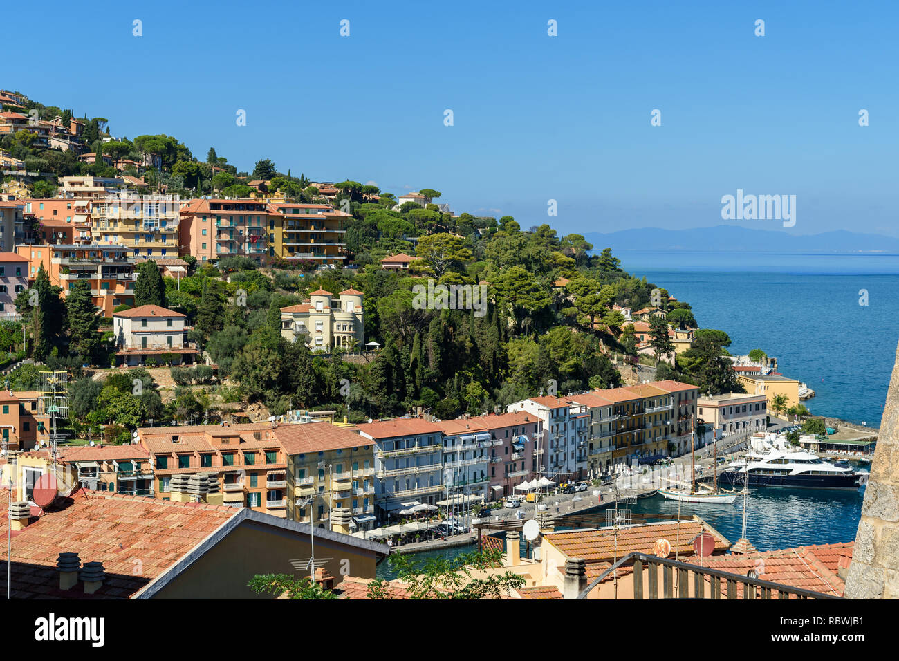 View of harbor seafront in seaport town Porto Santo Stefano in Monte Argentario. Tuscany. Italy - Stock Image